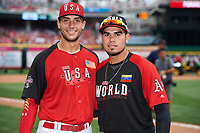 Team USA Matt Olson (left) and World Team Renato Nunez (right), both of the Oakland Athletics organization, pose for a photo after the All-Star Futures Game on July 12, 2015 at Great American Ball Park in Cincinnati, Ohio.  (Mike Janes/Four Seam Images)