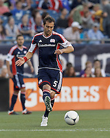 New England Revolution defender AJ Soares (5) passes the ball. In a Major League Soccer (MLS) match, the New England Revolution tied Houston Dynamo, 2-2, at Gillette Stadium on May 19, 2012.