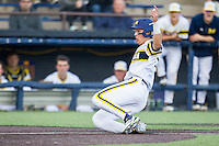 Michigan Wolverines first baseman Drew Lugbauer (17) slides safely at home against the Eastern Michigan Hurons on May 3, 2016 at Ray Fisher Stadium in Ann Arbor, Michigan. Michigan defeated Eastern Michigan 12-4. (Andrew Woolley/Four Seam Images)