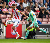 11th September 2021;  Bet365 Stadium, Stoke, Staffordshire, England; EFL Championship football, Stoke City versus Huddersfield Town; Tommy Smith of Stoke City under pressure from  Harry Toffolo of Huddersfield Town