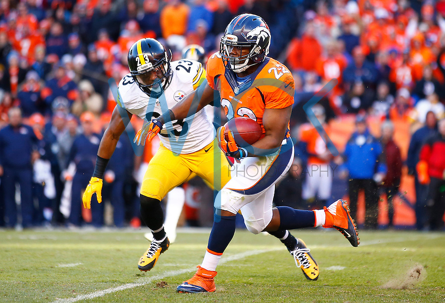 C.J. Anderson #22 of the Denver Broncos carries the ball past Mike Mitchell #23 of the Pittsburgh Steelers during the AFC Divisional Round Playoff game at Sports Authority Field at Mile High on January 17, 2016 in Denver, Colorado. (Photo by Jared Wickerham/DKPittsburghSports)