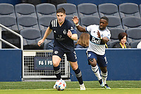 KANSAS CITY, KS - MAY 16: Andreu Fontas #3 Sporting KC with the ball during a game between Vancouver Whitecaps and Sporting Kansas City at Children's Mercy Park on May 16, 2021 in Kansas City, Kansas.
