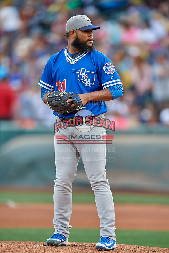 Oklahoma City Dodgers starting pitcher Daniel Corcino (31) looks home for the sign during the game against the Salt Lake Bees at Smith's Ballpark on July 31, 2019 in Salt Lake City, Utah. The Dodgers defeated the Bees 5-3. (Stephen Smith/Four Seam Images)
