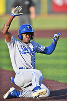 Burlington Royals Diego Hernandez (4) slides into third base during game one of the Appalachian League Championship Series against the Johnson City Cardinals at TVA Credit Union Ballpark on September 2, 2019 in Johnson City, Tennessee. The Royals defeated the Cardinals 9-2 to take the series lead 1-0. (Tony Farlow/Four Seam Images)