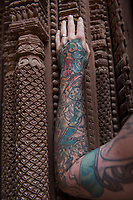 Nepal, Kathmandu. Durbar Square, Hanuman Dhoka, old palace of Malla Kings, damaged during the earthquake. Woman with tattoo arm.