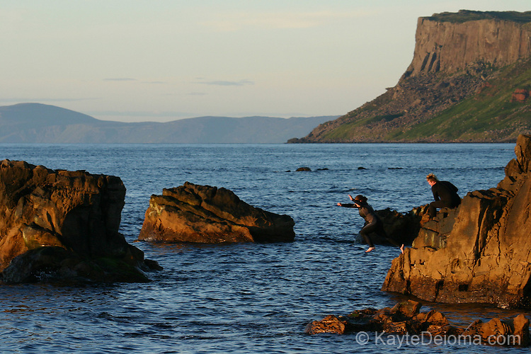 Jumping off of Pan's Rocks at Ballycastle Beach, Ballycastle, County Antrim, Northern Ireland