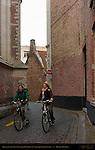 Bicyclists on Sint-Salvator Kerkhof St. Salvator Church Court, Bruges, Brugge, Belgium