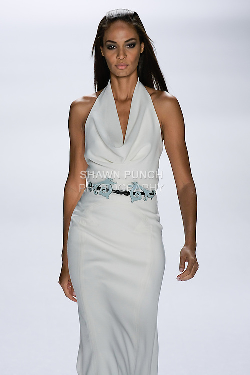 Joan Smalls walks runway in an outfit from the Carolina Herrera Spring 2013 Timeless Influence collection, during Mercedes-Benz Fashion Week Spring 2013 in New York City.