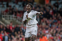 LONDON, ENGLAND - MAY 11 Bafetimbi Gomis of Swansea City  celebrates his late goal during  to the Premier League match between Arsenal and Swansea City at Emirates Stadium on May 11, 2015 in London, England.  (Photo by Athena Pictures/Getty Images)