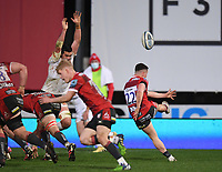 26th March 2021; Kingsholm Stadium, Gloucester, Gloucestershire, England; English Premiership Rugby, Gloucester versus Exeter Chiefs; Charlie Chapman of Gloucester kicks from the base of the ruck under pressure from Tom Price of Exeter Chiefs
