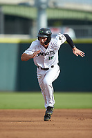 Jacob Gonzalez (18) of the Augusta GreenJackets hustles towards third base against the Kannapolis Intimidators at SRG Park on July 6, 2019 in North Augusta, South Carolina. The Intimidators defeated the GreenJackets 9-5. (Brian Westerholt/Four Seam Images)