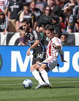 Chivas USA defender Jonathan Bornstein (13) tries to make a pass in front of DC United midifleder Ben Olsen (14). DC United defeated Chivas USA 2-1, at RFK Stadium in Washington DC, Sunday May 6, 2007.
