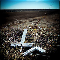 A broken cross from an unmarked grave is left on a junk pile near Yuma, Arizona, near the Arizona-Mexico border.
