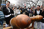 Apr 04, 2010 - Kawasaki, Japan - A visitor rides on a wooden phallic figure during the Kanamara Matsuri (Festival of the Steel Phallus) held in Wakamiya Hachimangu Shrine on April 4, 2010 in Kawasaki, Japan. The annual feritility festival, held traditionally the first Sunday in April, is said to encourage fertility and bring harmony to married couples. The festival has also become somewhat of a tourist attraction and is used to raise money for HIV research and awareness of AIDS prevention.