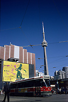 A tramway pass in front of an I Pod giant billboard ad on King and Spadina street.. the CN Tower is in the background.....The CN Tower, located in Toronto, Ontario, Canada, is the world's tallest freestanding structure on land, standing 553.33 meters (1,815 ft 5 in) tall. It is considered the signature icon of the city, attracting more than two million international visitors annually....Photo : Pierre Roussel - Images Distribution