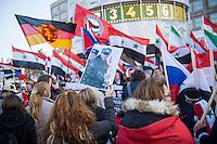 """250 bis 300 Menschen demonstrierten am Samstag den 31. Oktober 2015 in Berlin fuer die Unterstuetzung des syrischen Diktators Assad durch Russland. Sie trugen Fahnen Syriens, der ehemaligen Sowietunion, Russlands, Nordkoreas, der DDR, des Iran und Venezuelas, die sich """"alle zusammen gegen den Imperialismus zur Wehr setzen"""" wuerden. Russlands Praesident Putin wurde ausdruecklich fuer sein Militaerengagement gedankt, das Eingreifen der USA verurteilt.<br /> Im Bild: Eine Demonstrantin traegt ein Foto des russischen Praesidenten Putin.<br /> 31.10.2015, Berlin<br /> Copyright: Christian-Ditsch.de<br /> [Inhaltsveraendernde Manipulation des Fotos nur nach ausdruecklicher Genehmigung des Fotografen. Vereinbarungen ueber Abtretung von Persoenlichkeitsrechten/Model Release der abgebildeten Person/Personen liegen nicht vor. NO MODEL RELEASE! Nur fuer Redaktionelle Zwecke. Don't publish without copyright Christian-Ditsch.de, Veroeffentlichung nur mit Fotografennennung, sowie gegen Honorar, MwSt. und Beleg. Konto: I N G - D i B a, IBAN DE58500105175400192269, BIC INGDDEFFXXX, Kontakt: post@christian-ditsch.de<br /> Bei der Bearbeitung der Dateiinformationen darf die Urheberkennzeichnung in den EXIF- und  IPTC-Daten nicht entfernt werden, diese sind in digitalen Medien nach §95c UrhG rechtlich geschuetzt. Der Urhebervermerk wird gemaess §13 UrhG verlangt.]"""