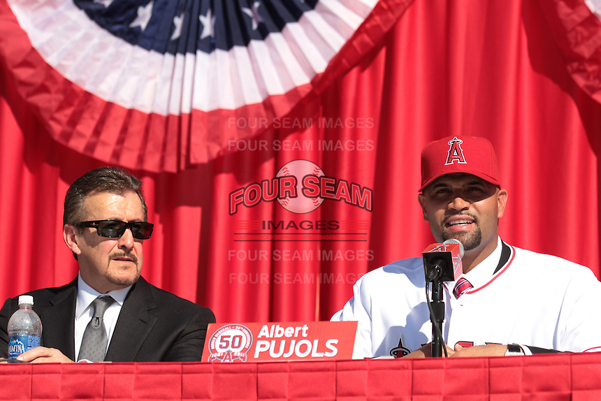 Los Angeles Angels Owner Arte Moreno with Albert Pujols (5) at press conference introducing Pujols as a new member of the Los Angeles Angels at Angel Stadium on December 10, 2011 in Anaheim,California.(Larry Goren/Four Seam Images)