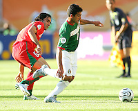 Zinha of Mexico gets the better of Javid Nekounam of Iran. Mexico defeated Iran 3-1 during a World Cup Group D match at Franken-Stadion, Nuremberg, Germany on Sunday June 11, 2006.