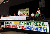 """Rio de Janeiro, Brazil. Imperatriz Leopoldinense samba school; preparations for carnival; press conference with a banner """"Our gold is nature. Our energy is life. Amazonia resists!""""."""