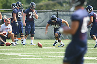 Virginia center Danny Aiken grabs a loose ball during open spring practice for the Virginia Cavaliers football team August 7, 2009 at the University of Virginia in Charlottesville, VA. Photo/Andrew Shurtleff