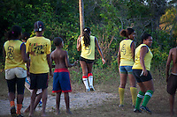 Women's soccer in a Brazilian quilombo - players wear the Brazilian national soccer team shirt. A quilombo is a Brazilian hinterland settlement founded by people of African origin. Most of the inhabitants of quilombos were escaped former slaves and, in some cases, a minority of marginalised non-slave Brazilians that faced oppression during colonization. Rio Grande Quilombo, Alcantara, Maranhao State, Northeastern Brazil.
