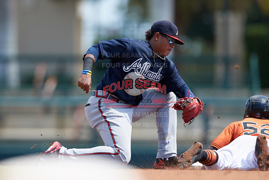 Atlanta Braves shortstop Kevin Maitan (50) tags Kirvin Moesquit (52) sliding safely into second base during an Instructional League game against the Baltimore Orioles on September 25, 2017 at Ed Smith Stadium in Sarasota, Florida.  (Mike Janes/Four Seam Images)