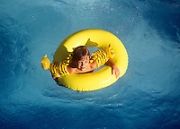 Boy in pool float.