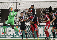 WASHINGTON, DC. - AUGUST 22, 2012:  Bill Hamid (28) of DC United saves in front of  Arnie Friedrich (23) of the Chicago Fire during an MLS match at RFK Stadium, in Washington DC,  on August 22. United won 4-2.