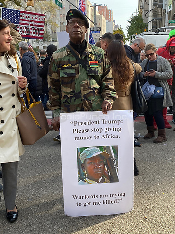 NEW YORK, NY - NOVEMBER 11:  Trump supporters and Anti-Trump protesters at the Veterans Day Parade opening ceremony during President Trump's speech delivered  inside Madison Square Park in New York, New York on November 11, 2019.  Photo Credit: Rainmaker Photo/MediaPunch