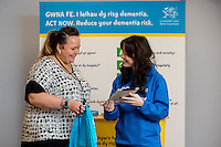 Friday 10 February 2017<br /> Pictured: Heidi Bater talks to promoter Louisa <br /> Re:Welsh Government Dementia Risk Prevention Roadshow at the BT building, Swansea, Wales, UK