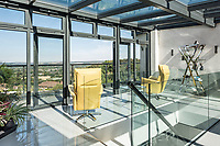 BNPS.co.uk (01202 558833)<br /> Pic: HamptonsInternational/BNPS<br /> <br /> 'Viewing gallery' in the top of the house...<br /> <br /> A futuristic 'Hollywood Hills' home which is nestled in the English countryside has emerged on the market for almost £5million.<br /> <br /> Harwin, in Bourne End, Bucks, would not look out of place on the big screen with its striking modern design.<br /> <br /> The five bedroom property which offers stunning views of the Thames Valley has its own cinema, gym and swimming pool.<br /> <br /> It is being sold with estate agent Hamptons International with a guide price of £4.75million.
