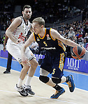 Real Madrid's Rudy Fernandez (l) and Alba Berlin's Niels Giffey during Euroleague match.March 12,2015. (ALTERPHOTOS/Acero)