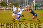 St Marys Daniel Daly in action making sure of this point scoring chance as Renard's Michael O'Leary fails to get the block.