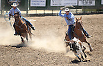 Russell Funk and Mike Johns compete in the team roping event at the Minden Ranch Rodeo on Saturday, July 23, 2011, in Gardnerville, Nev..Photo by Cathleen Allison