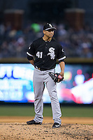 Chicago White Sox relief pitcher Javy Guerra (41) looks to his catcher for the sign against the Charlotte Knights at BB&T Ballpark on April 3, 2015 in Charlotte, North Carolina.  The Knights defeated the White Sox 10-2.  (Brian Westerholt/Four Seam Images)