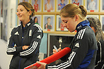 Englands Heather Knight autographs a bat. ..Cowbridge Comprehensive School Girls Cricket Club with England Womans Captain Charlotte Edwards and Heather Knight - 16th April 2013 - Cricket Wales -  Cowbridge - Vale of Glamorgan..© www.sportingwales.com- PLEASE CREDIT IAN COOK