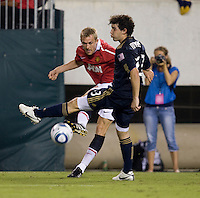 Darren Fletcher (24) of Manchester United has his cross blocked by Martin Rivas (33) of Philadelphia Union during a friendly match at Lincoln Financial Field in Philadelphia, Pennsylvania.  Manchester United defeated Philadelphia Union, 1-0.