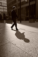 Shadow of a pedestrian on King Street West in downtown Toronto.....    photo by Pierre Roussel - Images Distribution