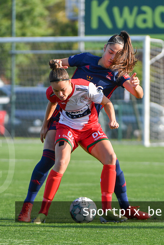 Charlotte Laridon (9) of Zulte Waregem and Amber Tysiak (3) of OH Leuven  pictured during a female soccer game between SV Zulte - Waregem and Oud Heverlee Leuven on the sixth matchday of the 2021 - 2022 season of Belgian Scooore Womens Super League , saturday 9 of October 2021  in Zulte , Belgium . PHOTO SPORTPIX | DIRK VUYLSTEKE