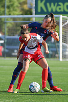 Charlotte Laridon (9) of Zulte Waregem and Amber Tysiak (3) of OH Leuven  pictured during a female soccer game between SV Zulte - Waregem and Oud Heverlee Leuven on the sixth matchday of the 2021 - 2022 season of Belgian Scooore Womens Super League , saturday 9 of October 2021  in Zulte , Belgium . PHOTO SPORTPIX   DIRK VUYLSTEKE