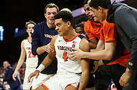ANDREW SHURTLEFF/THE DAILY PROGRESS <br /> Virginia players pick up teammate Justin McKoy (4) after being fouled during an ACC game in Charlottesville. Virginia defeated North Carolina 56-47.