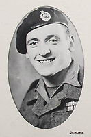 BNPS.co.uk (01202 558833)<br /> Pic: LindsayBurns/BNPS<br /> <br /> Pictured: A photograph of Marine Jock Mathieson.<br /> <br /> The medals, weapons and personal effects of a hero D-Day commando have sold for over £11,000 - 22 times their estimate.<br /> <br /> Marine Jock Mathieson narrowly escaped death during the Normandy landings on June 6, 1944.<br /> <br /> A bullet pierced the fuel tank of his motorbike which he was carrying above his head while wading through the sea towards Juno Beach.
