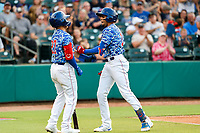 Tennessee Smokies center fielder Christopher Morel (11) celebrates a home run with shortstop Carlos Sepulveda (27) during the game against the Rocket City Trash Pandas at Smokies Stadium on July 2, 2021, in Kodak, Tennessee. (Danny Parker/Four Seam Images)