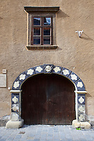 Baroque entrance to the old Gothic Jewish Sinagogue (Alt Synagoge) with the unusual 9 candle stand - Sopron, Hungary