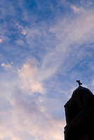 Steeple of a Roman Catholic Church, Silhouetted against Sky and Clouds at Dusk, Catherine Street, New York City, New York State, USA