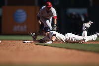SAN FRANCISCO - AUGUST 28:  Mark DeRosa #7 of the San Francisco Giants is tagged out at second base by Houston Astros shortstop Angel Sanchez #36 during the game at AT&T Park on August 28, 2011 in San Francisco, California. Photo by Brad Mangin