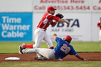 Batavia Muckdogs shortstop Anthony Melchionda #16 attempts to turn a double play as Carlos Lopez #20 slides in during a game against the Auburn Doubledays at Dwyer Stadium on June 18, 2012 in Batavia, New York.  Auburn defeated Batavia 6-5.  (Mike Janes/Four Seam Images)