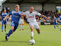 Pictured: Casey Thomas of Swansea (R) challenged by Legh de-Vulgt of Port Talbot (L). Saturday 17 July 2011<br />