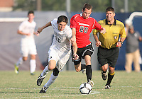 Andy Riemer #20 of Georgetown University battles for the ball with AJ Stueck #20 of Northeastern University during an NCAA match at North Kehoe Field, Georgetown University on September 3 2010 in Washington D.C. Georgetown won 2-1 AET.