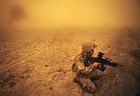 Afghanistan, 22.10.2011, Rahmat Bay. Nachdem bei Rahmat Bay festgefahre Dingo-Panzerwagen geborgen werden muessen, sichern Soldaten mitten in einem heftigen Sandsturm die Umgebung. Am Ende scherzen zwi Soldaten miteinander. Die in Kundus stationierte 3. Task Force (ISAF) der Bundeswehr beginnt im Oktober 2011 die mehrtaegige Operation Orpheus. Durch Patrouillen in und um die Kleinstadt Nawabad (Dirstrikt Chahar Dareh) westlich von Kundus, Nordafghanistan, versuchen die rund 100 Infanteristen Rueckzugsorte Aufstaendischer unmoeglich zu machen. Unterstuetzt werden sie dabei durch einen Zug afghanischer Soldaten. Two soldiers kidding. After two armored trucks of the ECHO platoon stuck in moody fields near Rahmat Bay, soldiers cover the area during a strong sandstorm while their comrades try to rescue the vehicles. In October 2011 Kunduz based 3.Task Force started a several days operation in and around Nawabad (District Chahar Dareh), west of Kunduz, northern Afghanistan. During the Operation Orpheus about 100 german infantry soldiers went out for patrols through the town and surrounding areas, which were expected as a retreat zone of insurgents. A platoon of afghan soldiers supports the german forces. © Timo Vogt/Est&Ost, NO MODEL RELEASE !! © Timo Vogt/Est&Ost, NO MODEL RELEASE !!